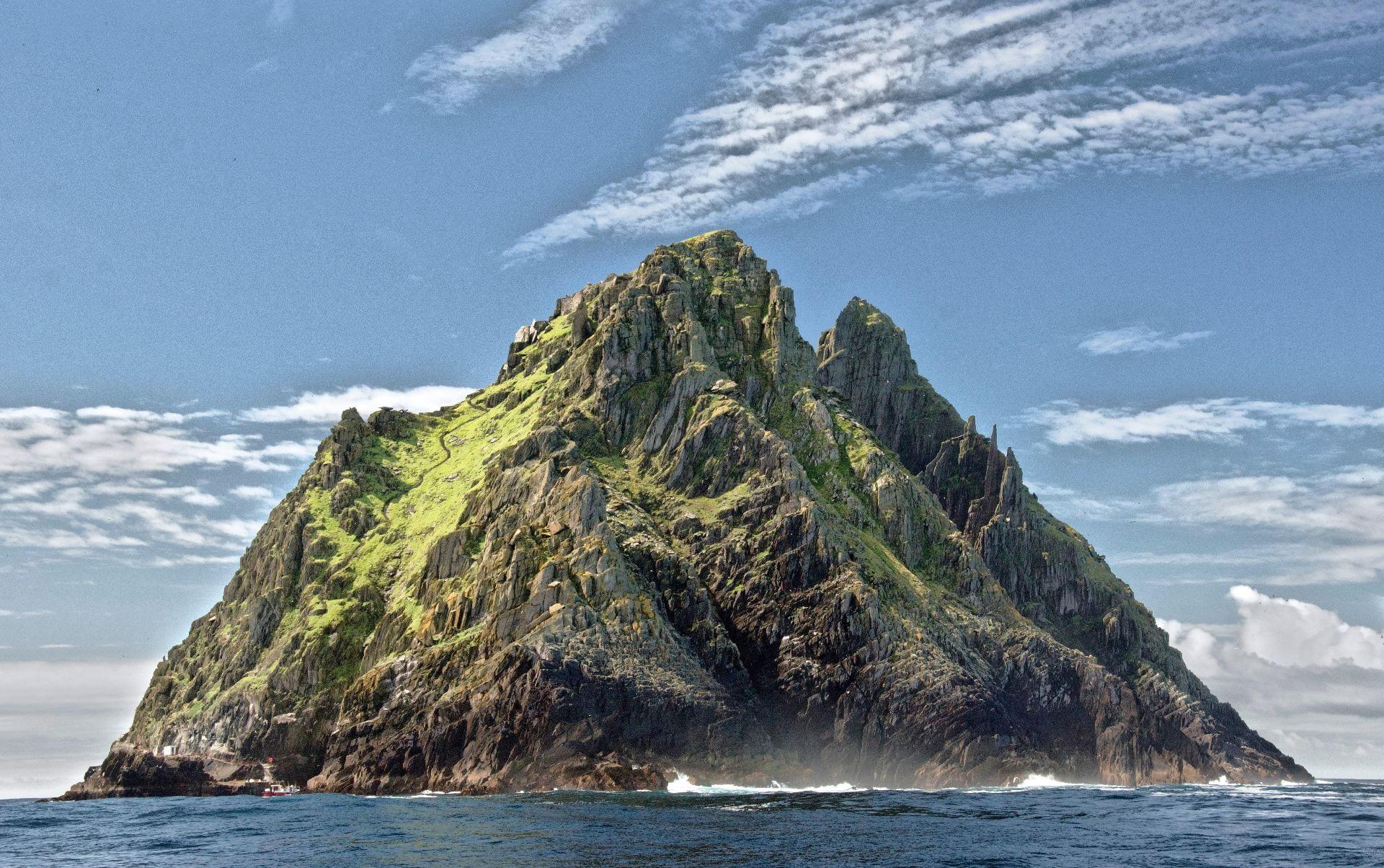 Vast, green mountainous island.