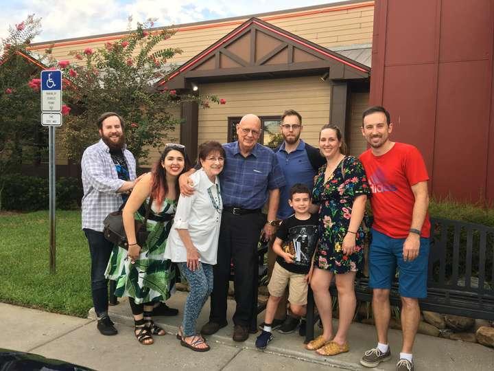 Group family shot outside of restaurant.