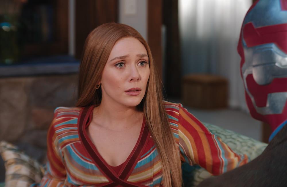 Wanda stares teary-eyed at Vision.
